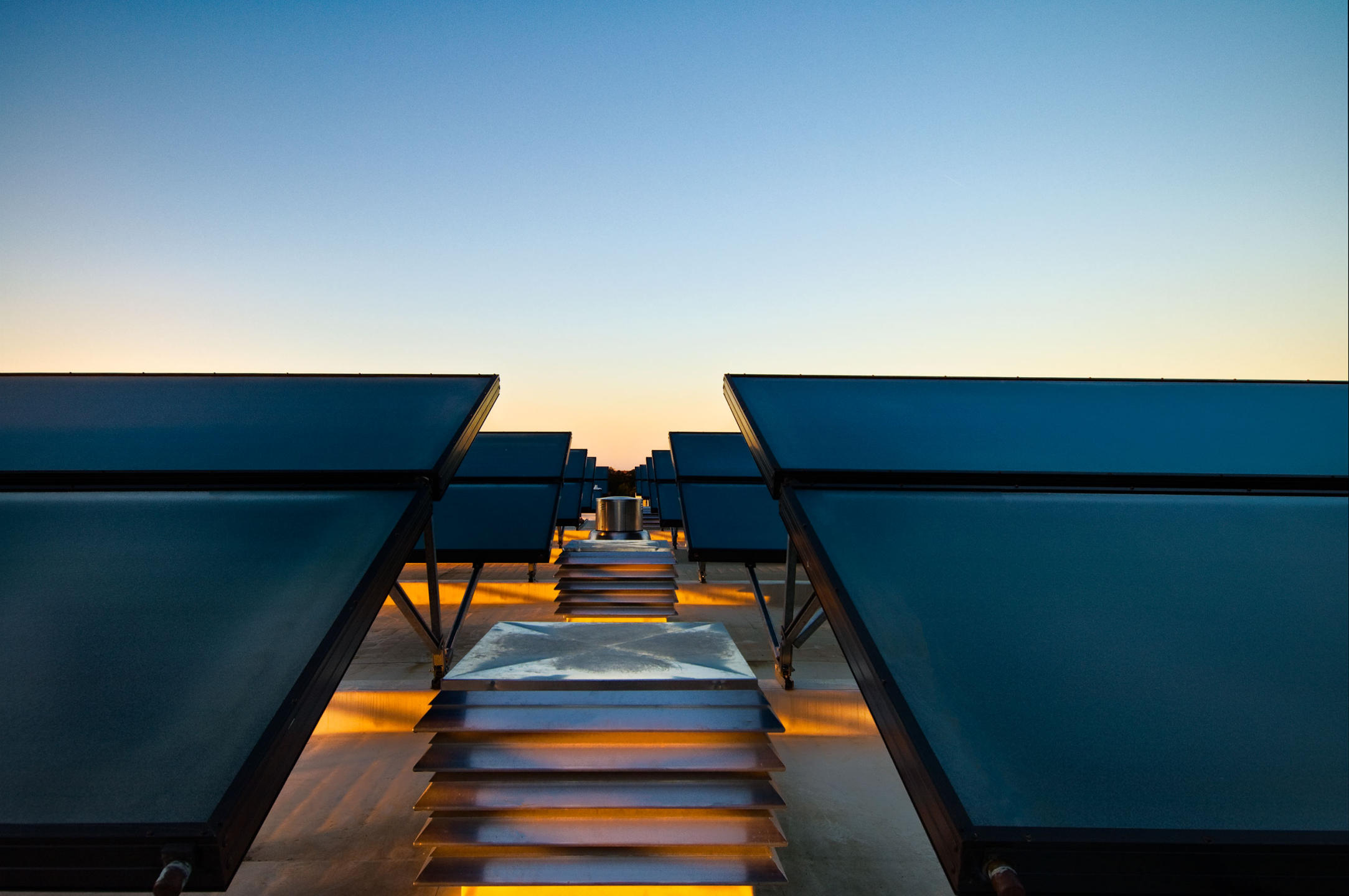 Sunset on the rooftop of the Proximity Hotel a LEED certified hotel utilizing solar panels to supply hot water to the rooms and restaurants. A Green hotel.   : Proximity Hotel : New York NY Architectural Photographer | Interior and Exterior